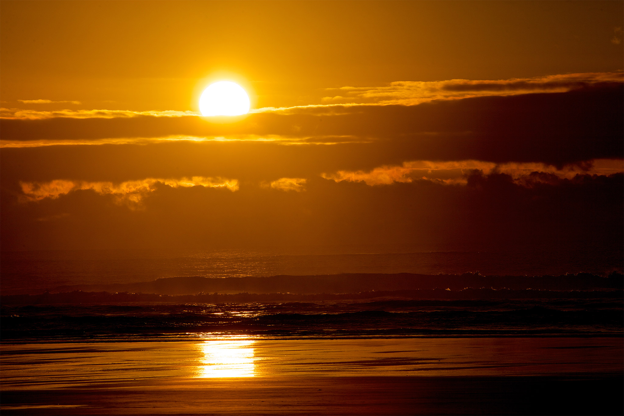 cannonbeachphoto-orange-sunset-over-the-pacific-ocean-horizontal-original